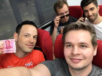 """Shenzhen Rangers"" (Maximilian, Jan, Martin, and Andreas) riding Line 11's business class"