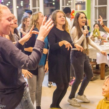 Dancing along to event host Noam Peleg singing KTV