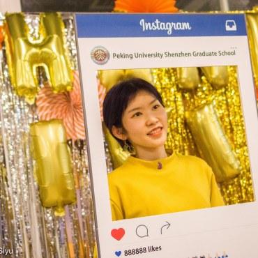 Myra Sun snapping an Instagram photo
